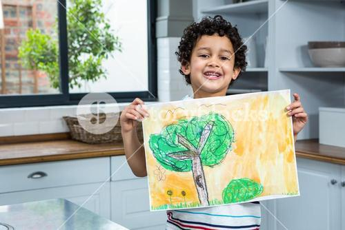 Cute child showing a drawing
