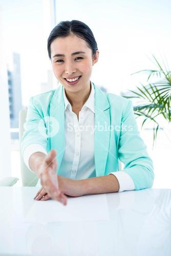Smiling businesswoman offering a handshake