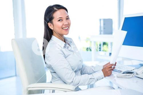 Smiling businesswoman holding document