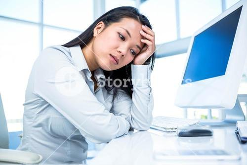 Thoughtful businesswoman with hand on face