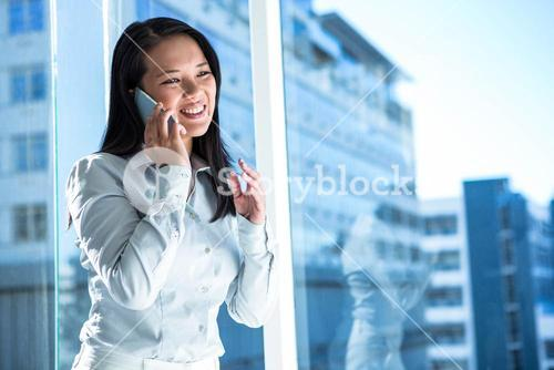 Smiling businesswoman on phone call