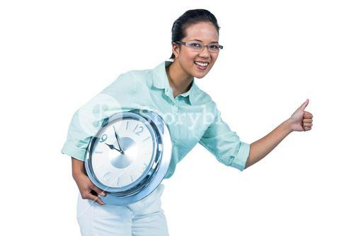 Delighted businesswoman holding a clock
