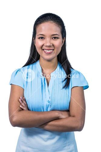 Smiling businesswoman with arms crossed