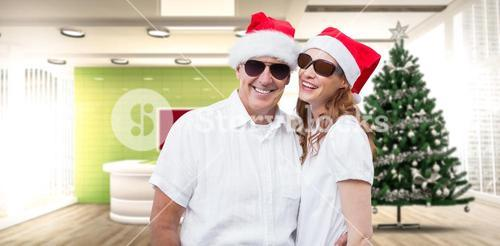 Composite image of festive couple smiling at camera