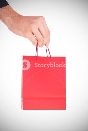 A Hand holding a gift bag