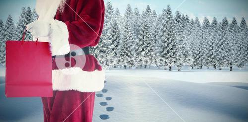 Composite image of santa carries red gift bag