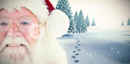 Composite image of santa claus is watching happy