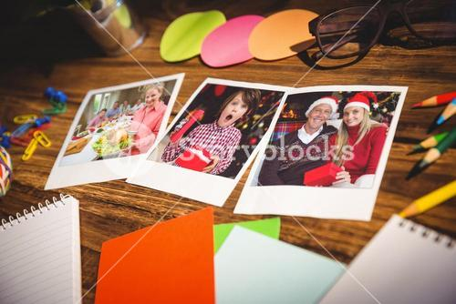 Composite image of high angle view of office supplies and blank instant photos