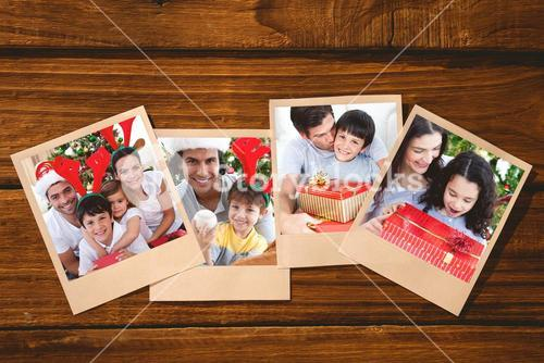 Composite image of lovely family giving presents for christmas