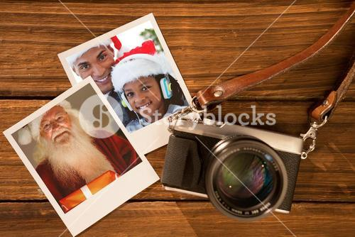 Composite image of happy santa holding a glowing gift