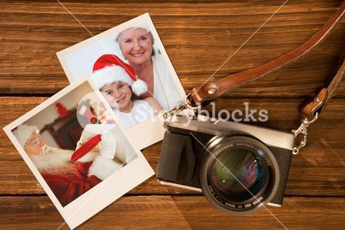 Composite image of smiling grandmother and little girl baking christmas cakes