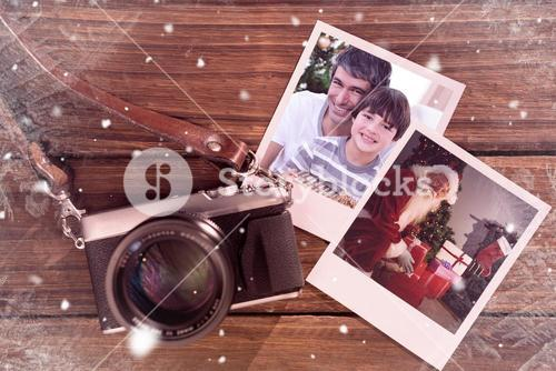 Composite image of father and son holding a christmas gift