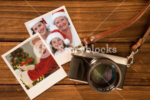 Composite image of smiling santa claus writing list