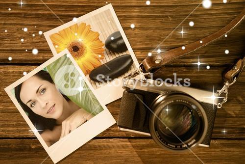 Composite image of beautiful nude brunette smiling at camera with green leaf