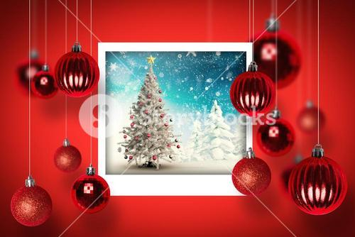 Composite image of christmas tree in snowy landscape