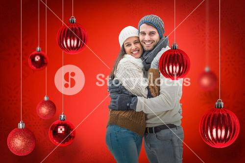Composite image of young winter couple