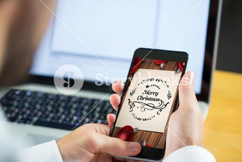 Composite image of businessman using smartphone