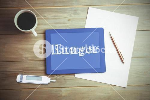 Hunger against high angle view of digital tablet and document with coffee