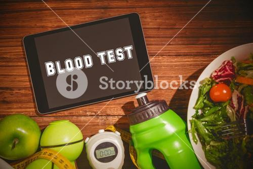 Blood test against tablet on healthy persons table