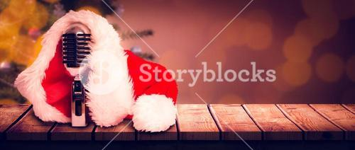 Composite image of vintage mic with santa hat