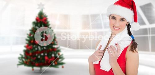 Composite image of festive fit brunette smiling at camera