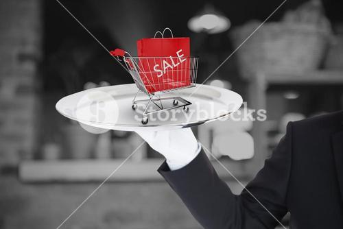 Composite image of hand with white gloves holding a silver tray