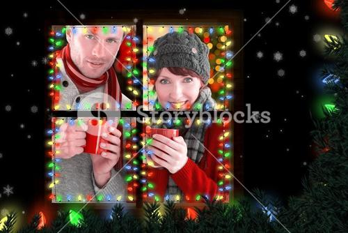 Composite image of couple both having warm drinks