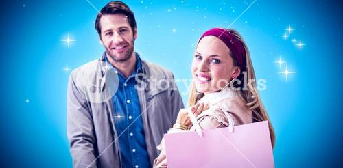 Composite image of smiling woman with shopping bag in front of cashier