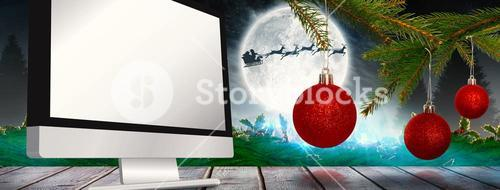 Composite image of baubles on tree