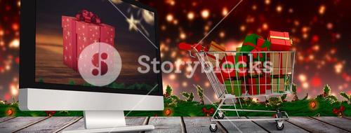 Composite image of trolley full of gifts