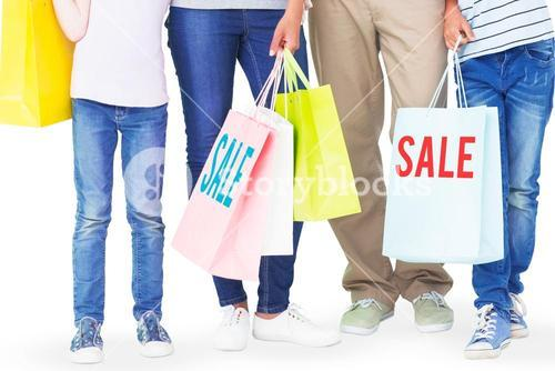 Composite image of family with shopping bags gesturing thumbs up