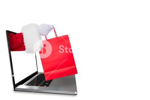 Composite image of father santa holding a shopping bag