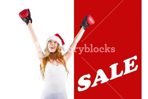 Composite image of festive redhead cheeering with boxing gloves