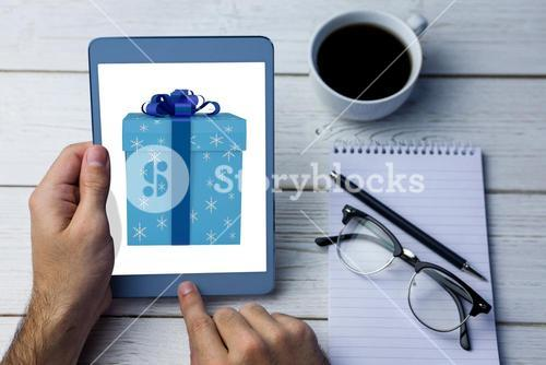 Composite image of blue and silver gift box
