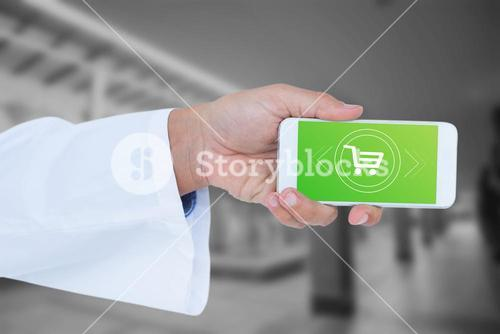Composite image of male doctor holding smart phone with blank screen
