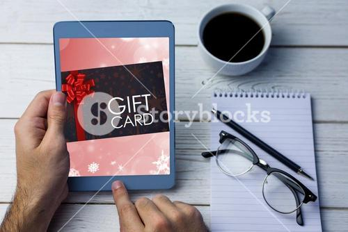 Composite image of gift card with festive bow