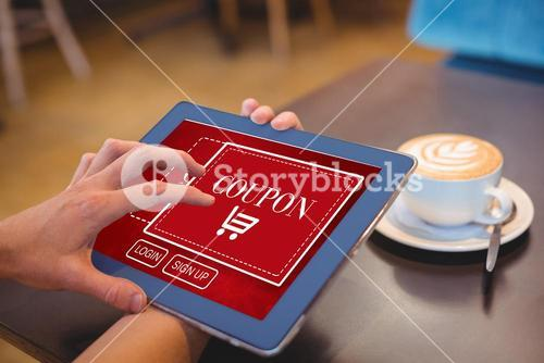 Composite image of hand holding digital tablet by table at home
