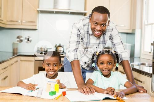Father helping children for homework