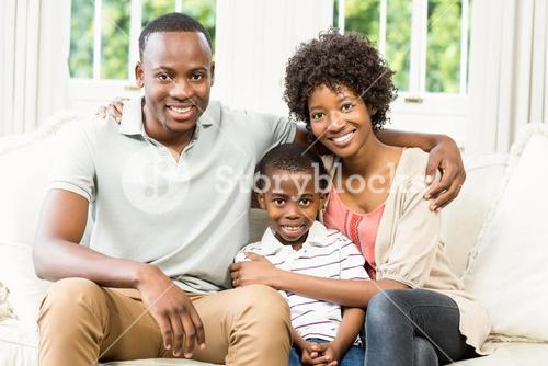 Happy family sitting on the couch