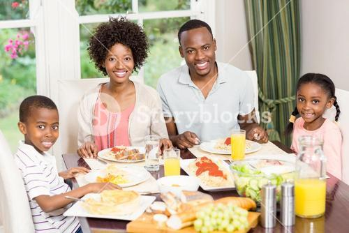 Portrait of happy family eating together
