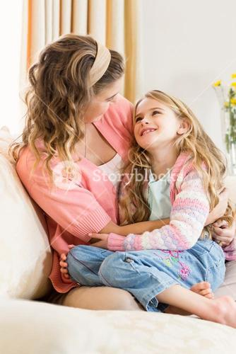 Mother and daughter smiling together