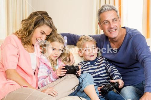 Happy family enjoying video games together