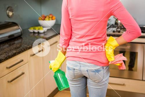 Midsection of woman ready to clean the kitchen