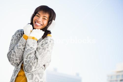 Portrait of smiling woman wearing winter clothes