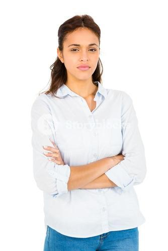 Worried woman with arms crossed