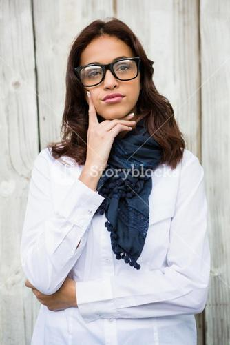 Thoughtful hipster woman with hand on chin