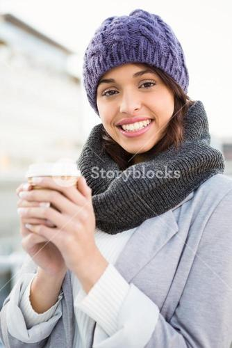 Smiling woman with take-away coffee