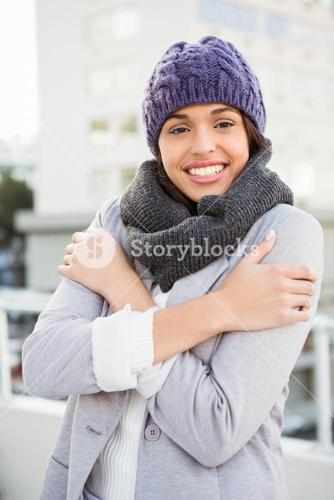 Thoughtful woman in winter coat trembling