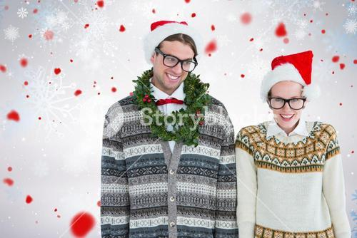 Composite image of smiling man wearing green garland by woman