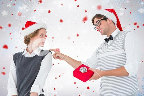Composite image of geeky hipster offering present to his girlfriend